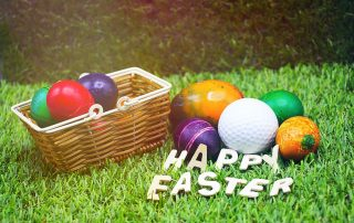 A golf ball mixed in with a pile of easter eggs